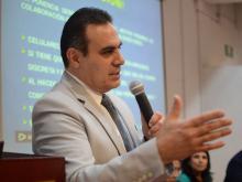 Dr. Igor Ramos, director de Salud Pública del CUCS, ofreciendo mensaje de bienvenida